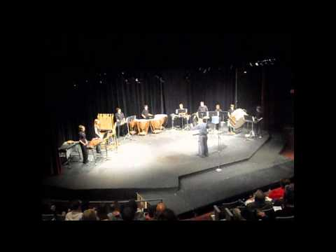 """Michael Grassman conducting the Waukesha Area Youth Percussion Ensemble with a self-composed piece entitled """"Shark Sandwich."""""""