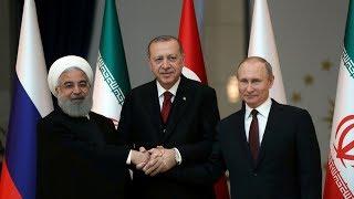 Russia, Iran, Turkey meet; slam US
