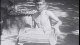 Bali: I Gde Manik playing  kendang 1930s