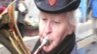 See Amid the winter snow Christmas carol Salvation Army band carolling