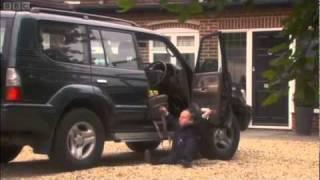 Dwarf falls out of a car