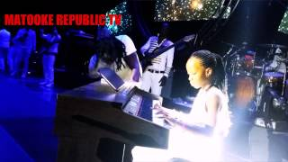 Bebe Cool's daughter Beata playing the piano
