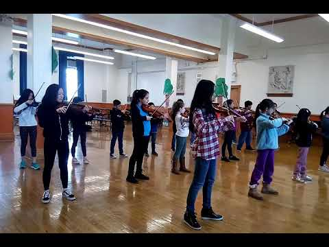 Violin Ensemble performing Allegro by Suzuki