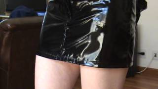 Lady In PVC/vinyl Miniskirt And Jacket And Leather Pants