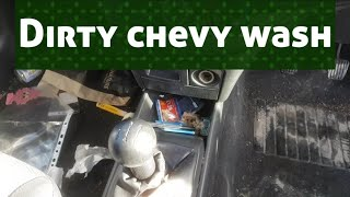 Cleaning a really dirty chevrolet car.