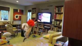 Kid in red wig dances to DEVO Post Post-Modern Man