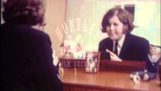 Woman applies lipstick.  Archive film 91704