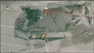 Construction Excavator Falls Through Roof in Yonkers