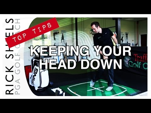 KEEPING YOUR HEAD DOWN IN GOLF SWING