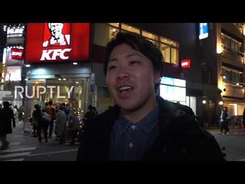 Japan: People queuing in front of KFC to get fried Christmas treats