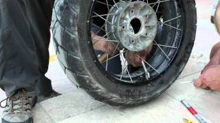 preview picture of video 'Replacing broken spoke on BMW R1200GS Adventure traveling the world'