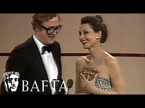 Audrey Hepburn presents Michael Caine with his BAFTA in 1984