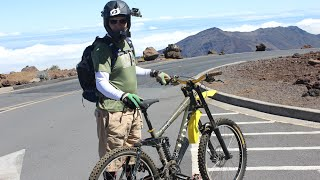 Summit Building parking lot before dropping 18 miles down some 7,000 ft along Skyline, Mamane and through Poli Poli State Park on Waipoli Rd to Highway 37. Breaks for battery changes, pictures and seat adjustments. . .