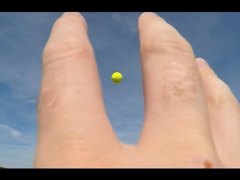 GoPro wrist strap, catching a tennis ball.