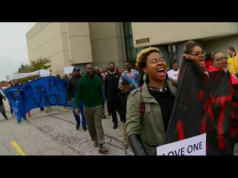 Protesters on Saturday marched through an Alabama shopping mall where police killed a black man they later acknowledged was not the triggerman in a Thanksgiving night shooting that wounded two people. (Nov. 24)
