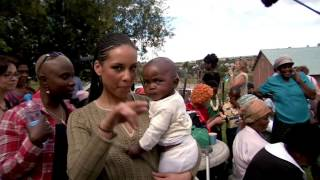 Alicia Keys in Africa to help fight HIV/AIDS with her Keep a Child Alive non-profit charity (2006)