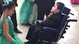 Girl dance with brother having cerebral palsy