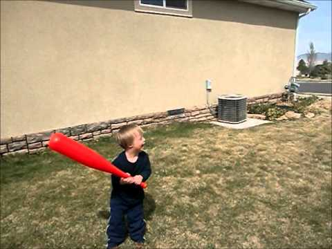 Watch video Down Syndrome toddler playing Baseball
