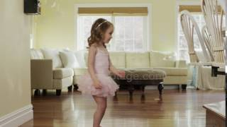 Medium Slow Motion Panning Shot Of Girl Dancing In Ballerina Costume