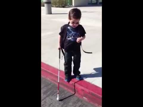 4-year-old blind boy steps off the curb for the first time by himself