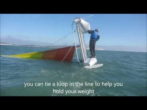 Righting an inverted catamaran