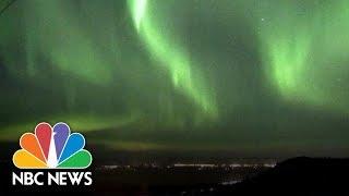 Watch The Green Glow Of The Northern Lights Across The Alaskan Sky | NBC News