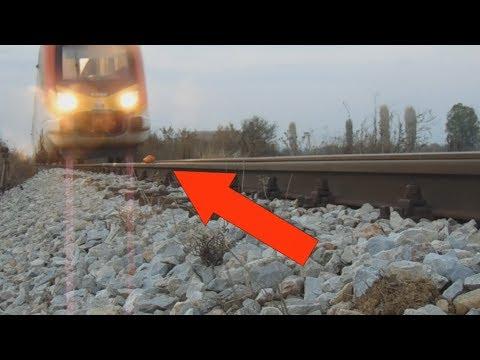 EXPERIMENT TRAIN VS TOMATOES Loram rail grinder under train view