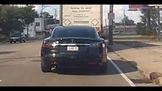 Nice black Tesla Model S driving towards East Peoria.