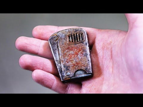 Old rusty squeeze lighter restoration