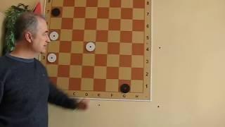Как поймать тремя дамками одну дамку в шашках