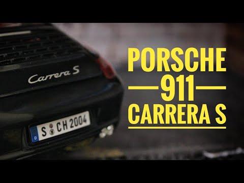 Металлическая машинка Maisto 1:18 «Porsche 911 Carrera S» 31692 / Черный
