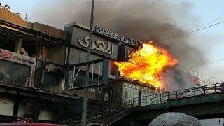 حريق الموسكي ... النيران تلتهم ملايين المحلات