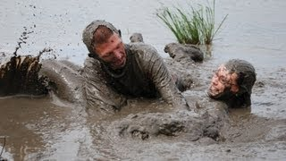Cute couple plays in the mud