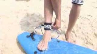 Learn to Surf Lesson 7: Attaching a Leash and Carrying a surfboard