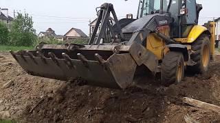 Планировка участка экскаватором-погрузчиком Volvo г. Иваново