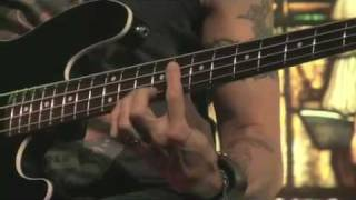 Behind the player Duff McKagan bassist for Velvet Revolver a College video