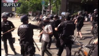 Police intervene as right-wing protesters face off with counter-demonstrators in Seattle