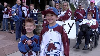 Avalanche fans cheer on their team to victory over the Predators