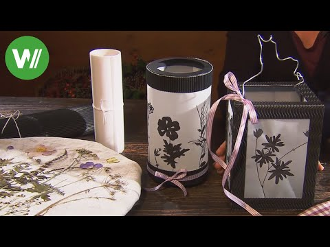 Laternen mit Motiven von gepressten Blüten und Gräsern