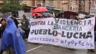 Hundreds brave weather to protest in Spain