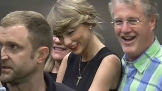 EXCLUSIVE: Taylor Swift Wears LBD For Flight To Tokyo With Parents