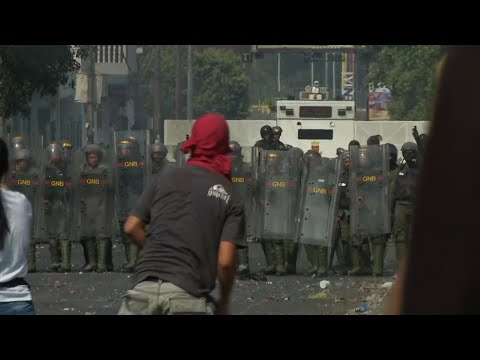 Venezuela's National Guard has fired tear gas on residents clearing a barricaded border bridge between Venezuela and Colombia to let humanitarian aid pass through. (Feb. 23)