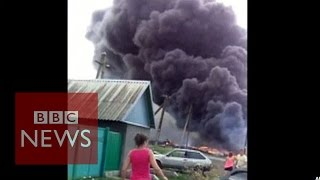 MH17: New Footage Shows Crash Aftermath - BBC