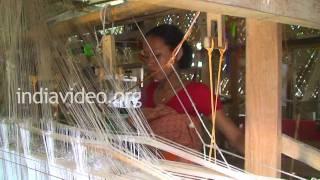 Women weaving silk in Sualkuchi, Assam