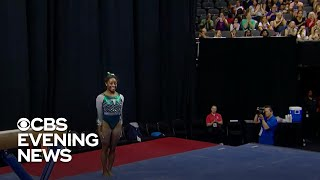 """Simone Biles became the first women to complete the """"triple double"""" in competition. She won the """"all-around"""" at the U.S. Gymnastics Championships, her record-tying sixth national title. Norah O'Donnell reports.  Subscribe to the """"CBS Evening News"""" Channel HERE: http://bit.ly/1S7Dhik Watch Full Episodes of the """"CBS Evening News"""" HERE: http://cbsn.ws/23XekKA Watch the latest installment of """"On the Road,"""" only on the """"CBS Evening News,"""" HERE: http://cbsn.ws/23XwqMH Follow """"CBS Evening News"""" on Instagram: http://bit.ly/1T8icTO Like """"CBS Evening News"""" on Facebook HERE: http://on.fb.me/1KxYobb Follow the """"CBS Evening News"""" on Twitter HERE: http://bit.ly/1O3dTTe Follow the """"CBS Evening News"""" on Google+ HERE: http://bit.ly/1Qs0aam  Get your news on the go! Download CBS News mobile apps HERE: http://cbsn.ws/1Xb1WC8  Get new episodes of shows you love across devices the next day, stream local news live, and watch full seasons of CBS fan favorites anytime, anywhere with CBS All Access. Try it free! http://bit.ly/1OQA29B  --- The """"CBS Evening News"""" premiered as a half-hour broadcast on Sept. 2, 1963. Check local listings for CBS Evening News broadcast times."""
