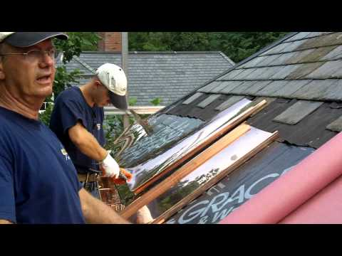 Tony Pedro, project manager, describes how he is installing a copper panel roof system in Wellesley, Ma which ties into the slate roof and copper gutters.