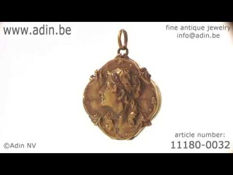 Typical Art Nouveau gold locket with woman head. (Adin reference: 11180-0032)