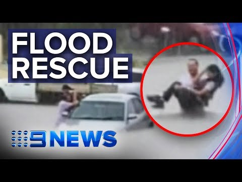 Woman saved from car stuck in Victoria flood | Nine News Australia