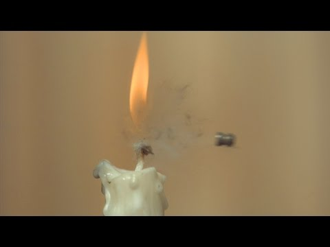 Watch An Air Pistol Pellet Slice The Flame Of A Candle In Slow Motion