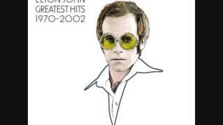 Gambar cover Elton John - Rocket Man (I Think It's Going To Be A Long Long Time) (Greatest Hits 1970-2002 4/34)
